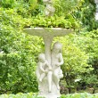 White children statues in the garden — Stock Photo