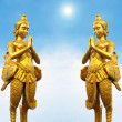 Golden Thai style statues acting Wai or Sawasdee — Stock Photo