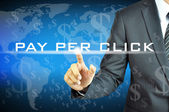 Businessman touching PAY PER CLICK on virtual screen — Stock Photo