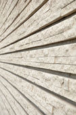 Grooved decorative stone wall texture — Stock Photo