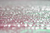 Water flow on grooved stone - bokeh abstrcat background — Stock Photo