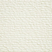White grooved decorative stone wall texture — Stock Photo
