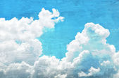 Retro style picture of blue sky and clouds — Stock Photo