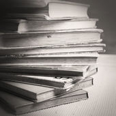 A stack of books in black and white — Stock Photo