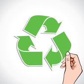 Recycle symbol in hand — Vector de stock