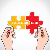 Partnership puzzle piece in hand — Stock Vector