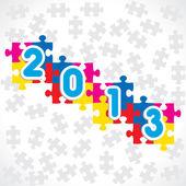 Tarjeta de felicitación de año nuevo con piezas del rompecabezas — Vector de stock