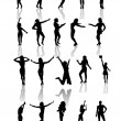 Set of silhouettes of dancing and jumping girls. — Stock Vector