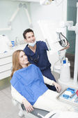 Dentist and patient looking at the monitor — Stock Photo
