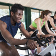 Three Friends Are In Spinning Class At Gym — Stock Photo #22744433