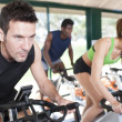 Royalty-Free Stock Photo: Three Friends Are In A Spinning Class At Gym