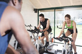Two Friends Are In A Spinning Class At Gym — Stock Photo