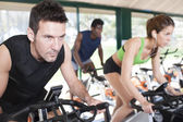 Three Friends Are In A Spinning Class At Gym — Stock Photo