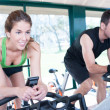Two Friends Are In Spinning Class At Gym — Stock Photo #24568601