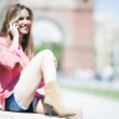 Young smiling woman using a cellphone at street in Barcelona — Stock Photo