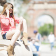 Young smiling woman using a cellphone at street in Barcelona — Stock Photo #24925961
