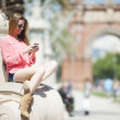 Young smiling woman using watsap at street in Barcelona — Stock Photo #24925983