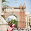 Young smiling woman using watsap at street in Barcelona — Stock Photo