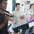 Three athletes in the treadmill - ストック写真
