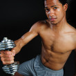 Black athlete lifting weights — Stock Photo