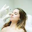 Giving botox procedure — Stock Photo #27150191