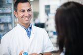 The pharmacist resolves all doubts of his client — Stock Photo