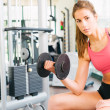 Girl working hard at gym — Foto Stock