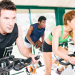 Three Friends Are In A Spinning Class At Gym — Stock Photo #28486065