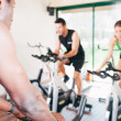 Three Friends Are In Spinning Class At Gym — Stock Photo #28487163