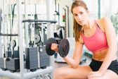 Girl working hard at gym — Stock Photo