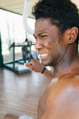 Black man during his gym workout — Stock Photo
