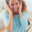 Happy girl dancing at home while listen music with headphones — Stock Photo #29830551