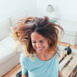 Stock Photo: Happy girl dancing at home