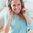 Happy girl dancing at home — Stock Photo