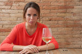 Woman and a glass of white wine — Stock Photo