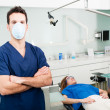 Dentist in his surgery — Stock Photo