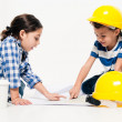 2 small kids playing at being little workers — Stock Photo