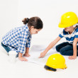 2 small kids playing at being little workers — Stockfoto