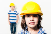 2 small kids playing at being little workers — Foto Stock
