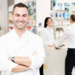 Cheerful smiling pharmacist — Stock Photo