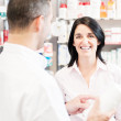 Smiling customer in a pharmacy — Stock Photo
