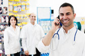 Pharmacist talking on the phone — Stock Photo
