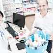 Pharmaceutical attending a customer — Stock Photo