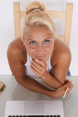 Blonde woman with sultry look. She is in her workplace — Stock Photo