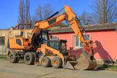 Parked excavator — Stock Photo