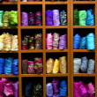 Stock Photo: Showcase with colorful silk scarves