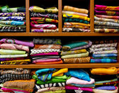 Showcase with colorful silk scarves — Stock Photo