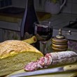 Salami, red wine and bread (salame,vino rosso e pane) — Stock Photo #24410087