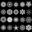 Stock Vector: Set of snowflakes silhouettes