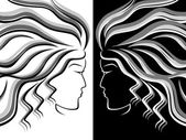 Female head silhouettes — Stock Vector